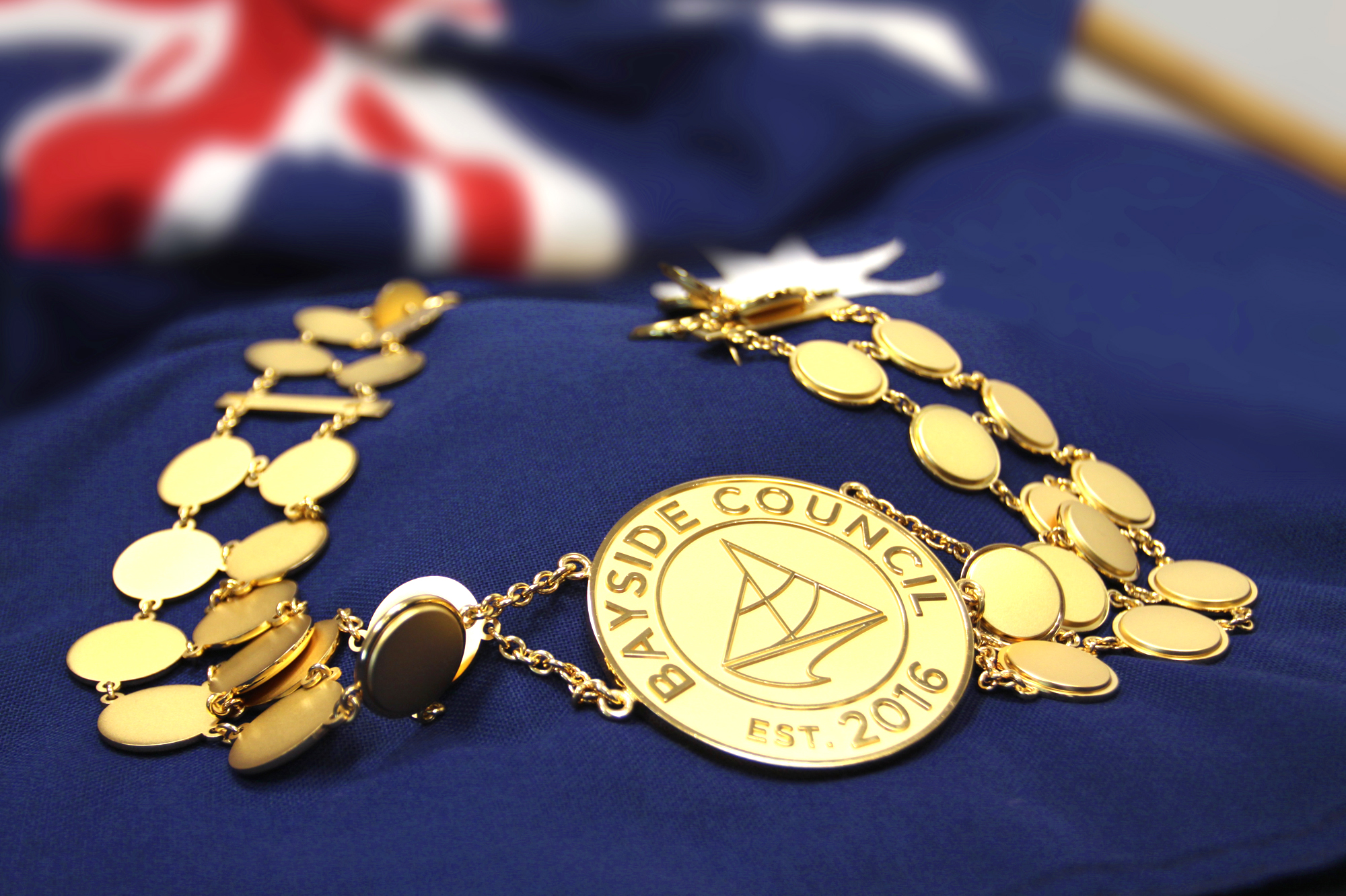 Mayoral gold chain on an Australian Flag